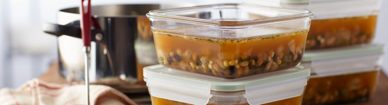 Close up of tupper ware filled will soup