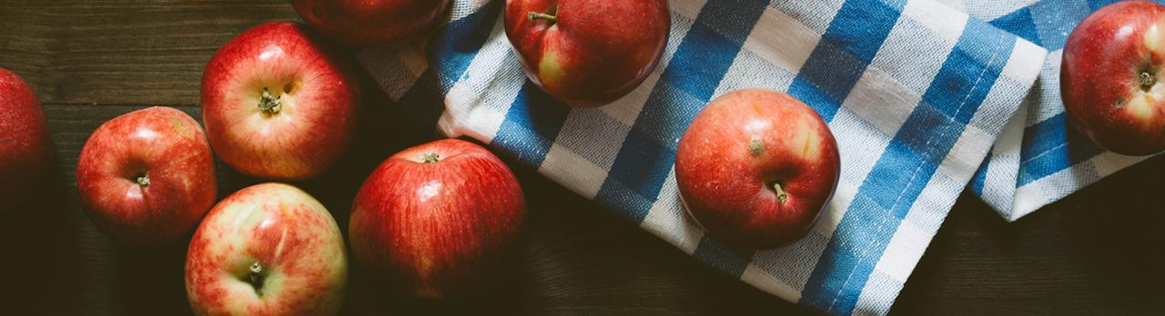 Apples on a counter top.